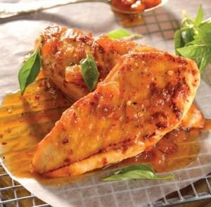 Pechugas de pollo con salsa de duraznos y naranja